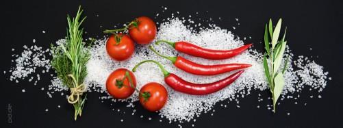 Glasbild Italienische Küche - Tomaten und Peperoni